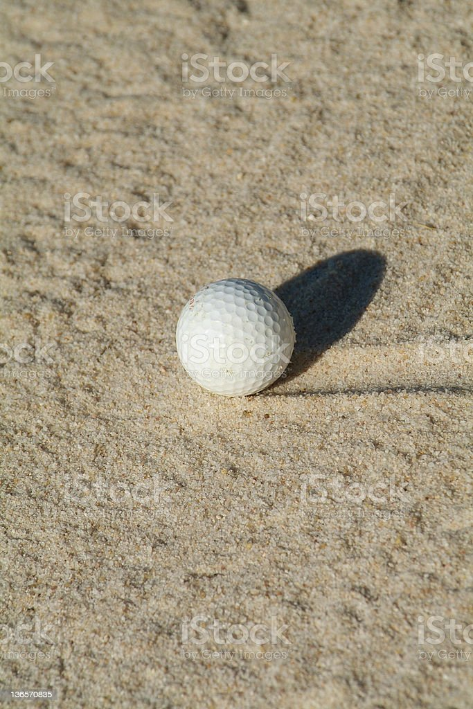 Golf ball in bunker royalty-free stock photo