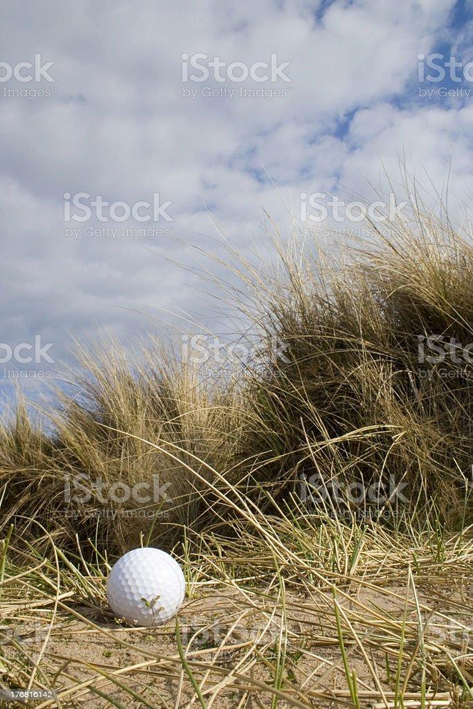 Golf ball in dunes 2 stock photo