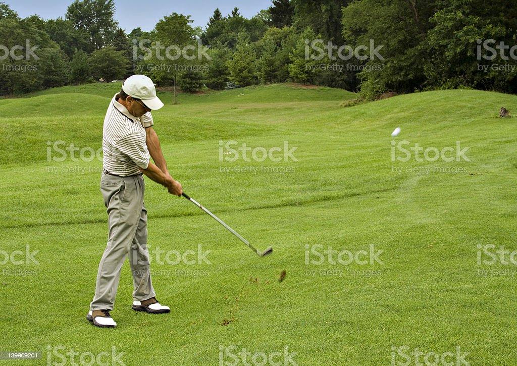 Golf Ball in Flight royalty-free stock photo