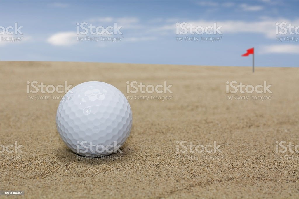 golf ball in sand stock photo