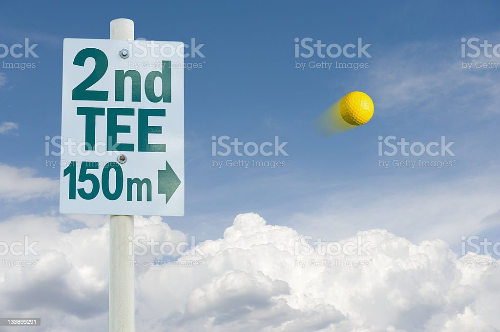 Golf ball in the flight royalty-free stock photo