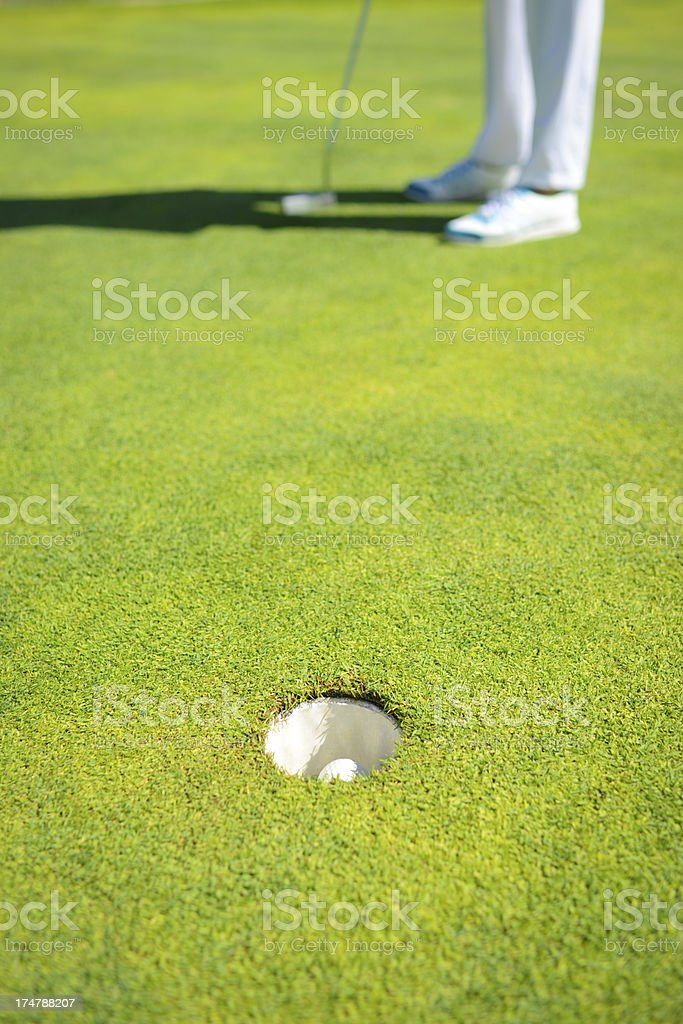 Golf Ball In The Hole royalty-free stock photo