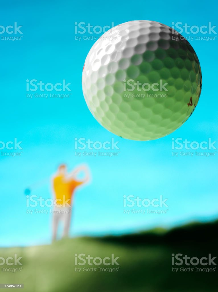 Golf Ball in the Mid Air royalty-free stock photo