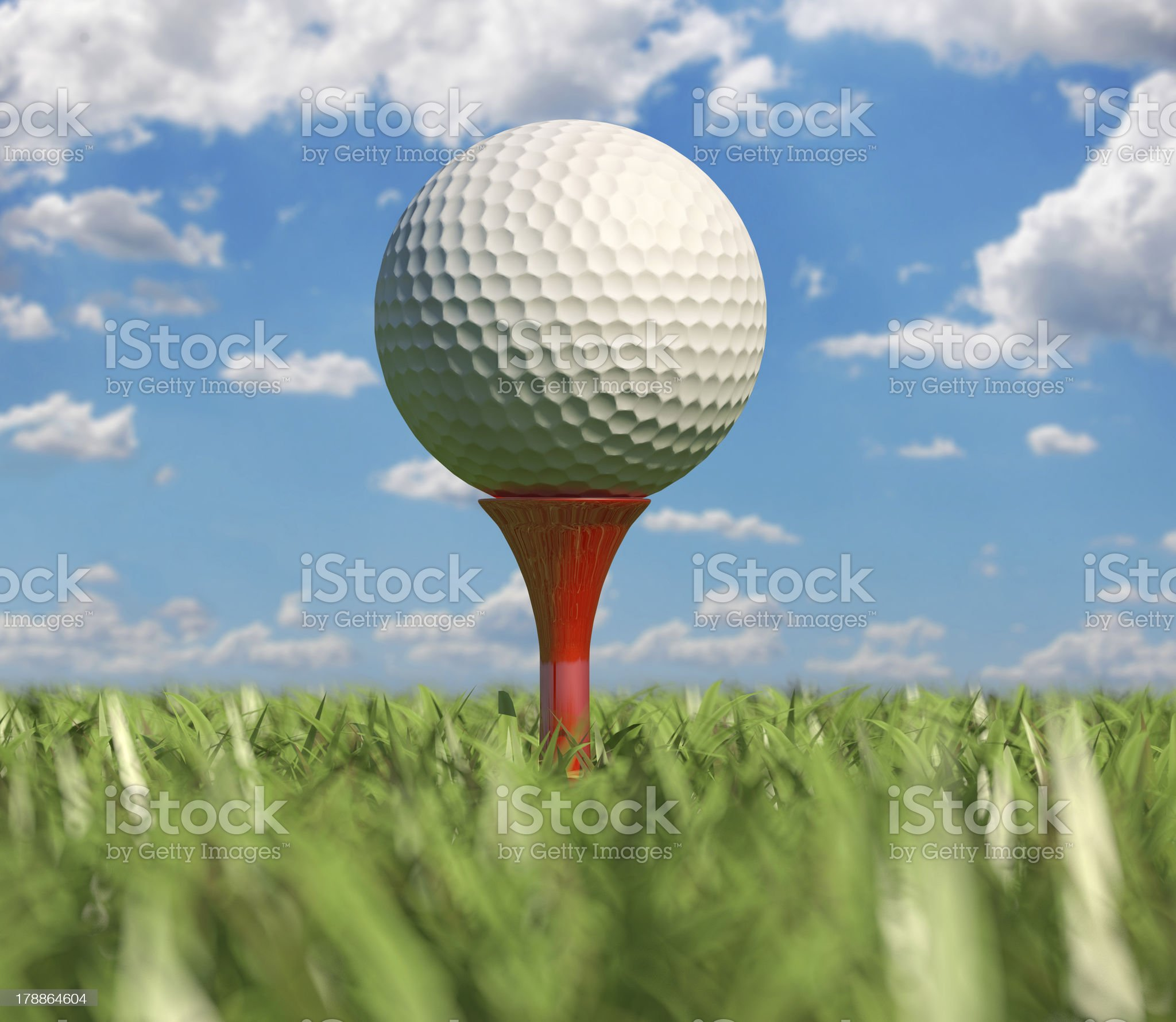 Golf ball isolated on tee in the grass. Close-up. royalty-free stock photo