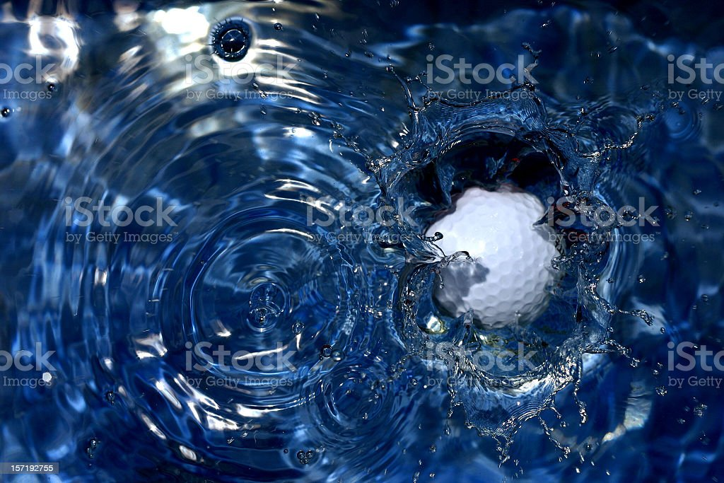 Golf Ball landing in Water stock photo