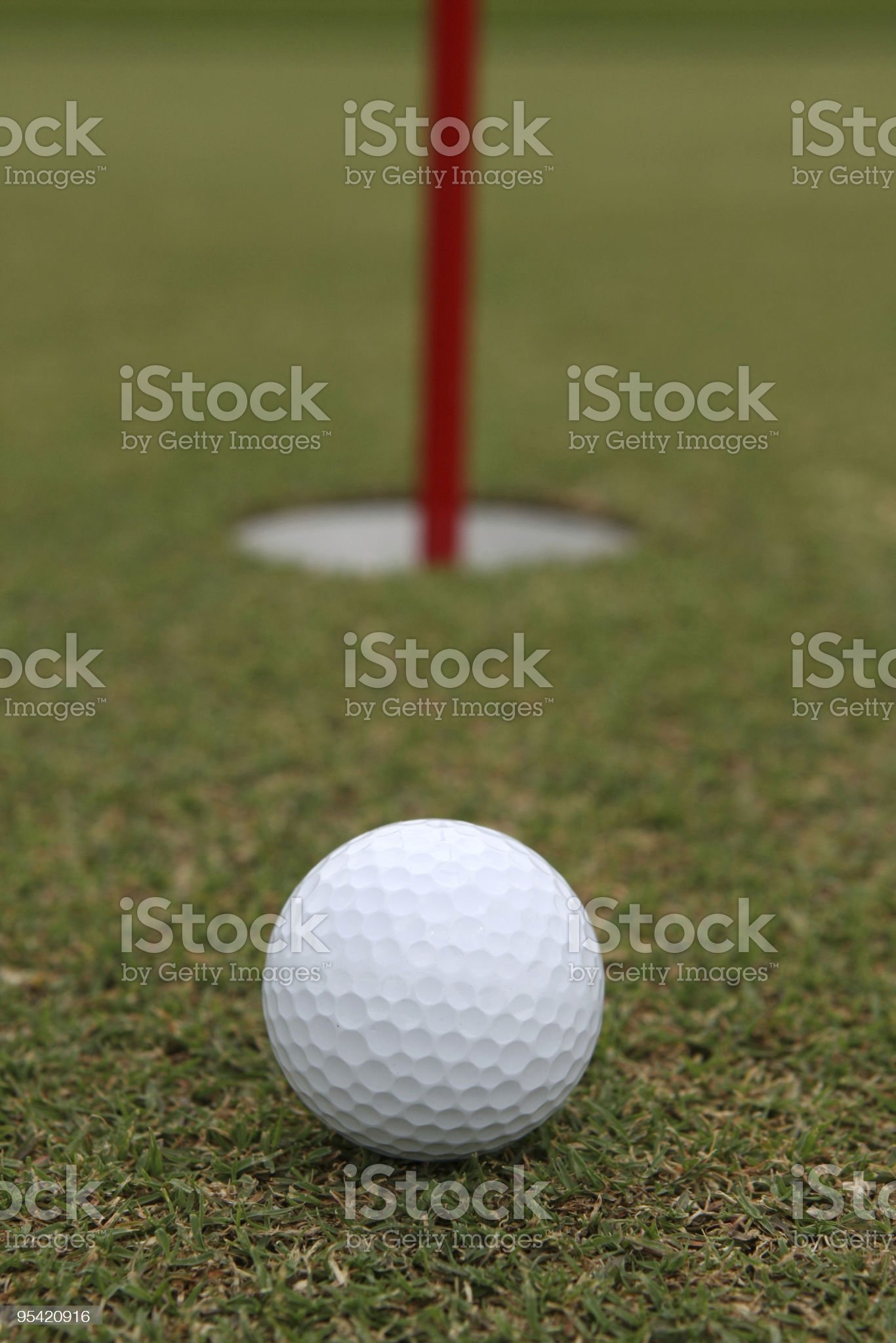 Golf ball near hole of the Course royalty-free stock photo