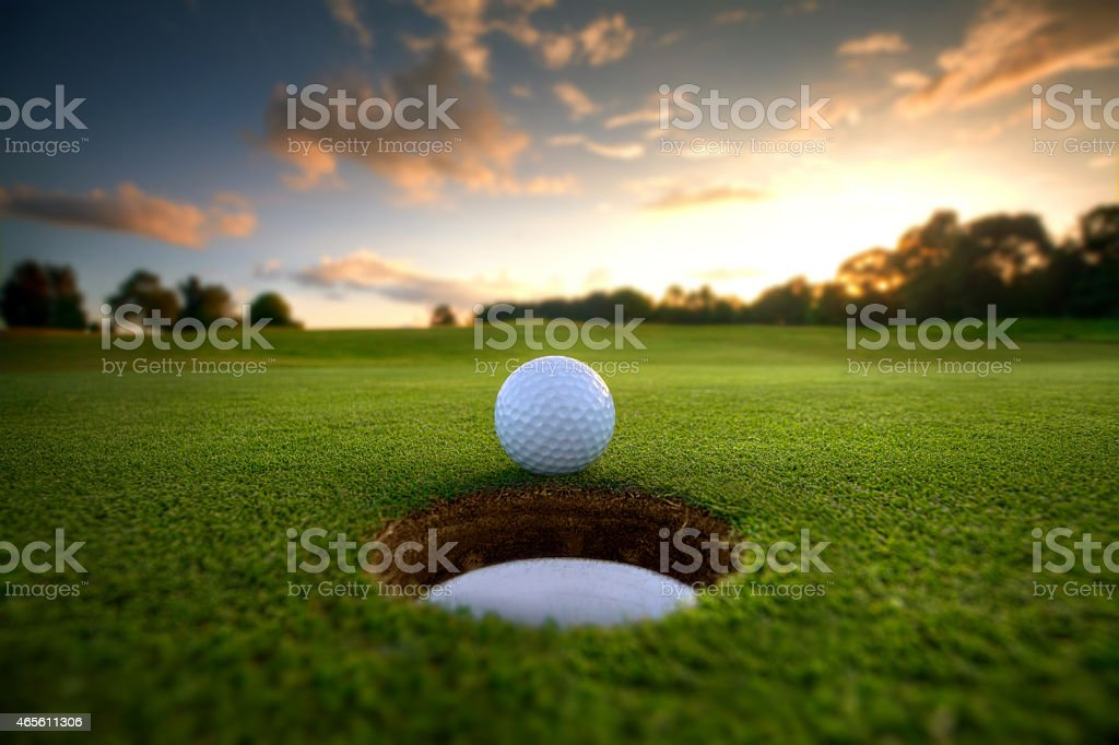Golf Ball near hole royalty-free stock photo