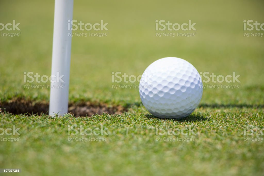 Golf Ball Near Hole stock photo