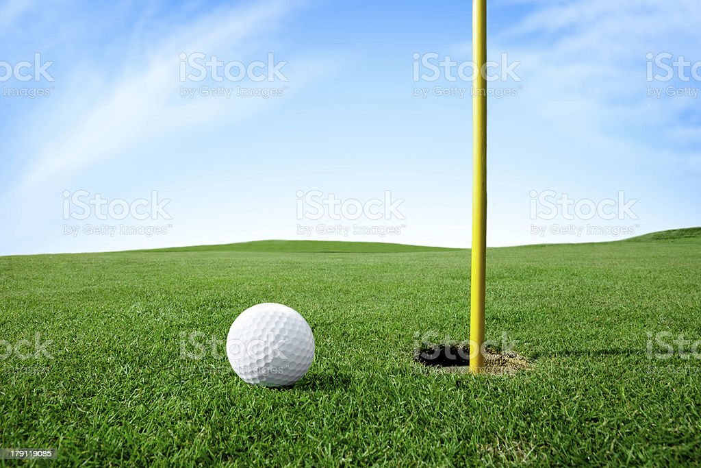 Golf ball next hole royalty-free stock photo