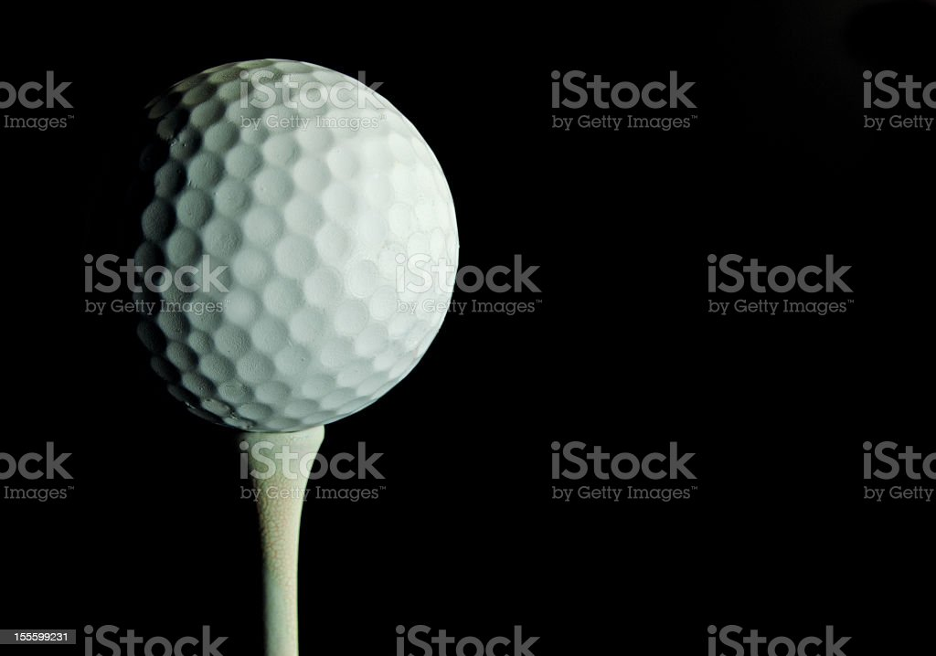 Golf Ball Off Center on Black royalty-free stock photo