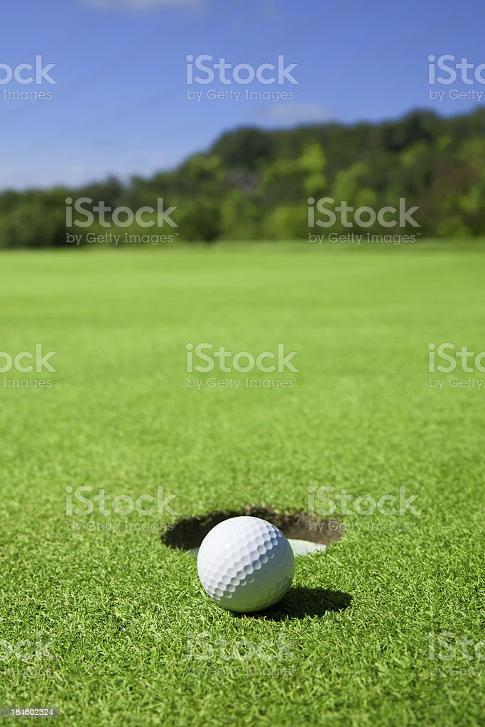 Golf Ball On Edge of Hole royalty-free stock photo