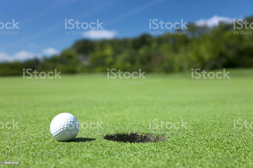 Golf Ball On Edge of Hole royalty-free stock photo