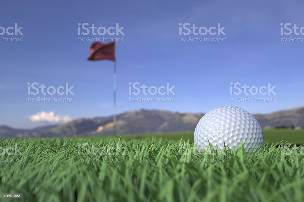 Golf Ball on Grass Field with Flag Background stock photo