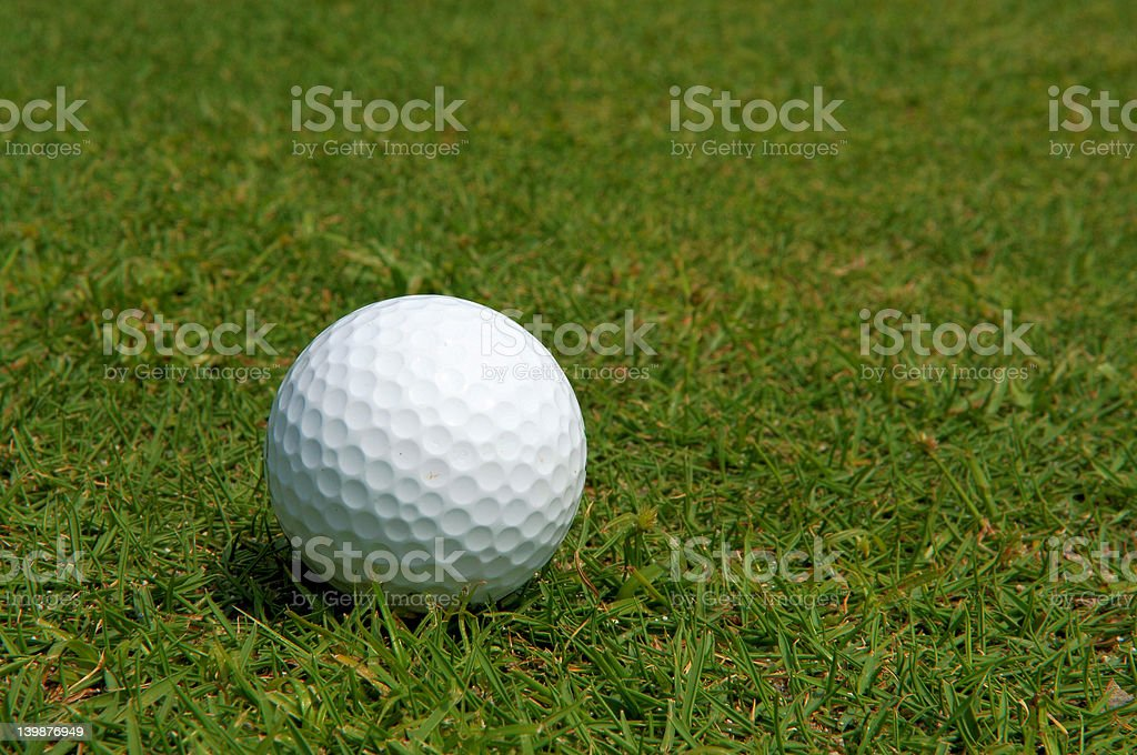 golf ball on green grass royalty-free stock photo