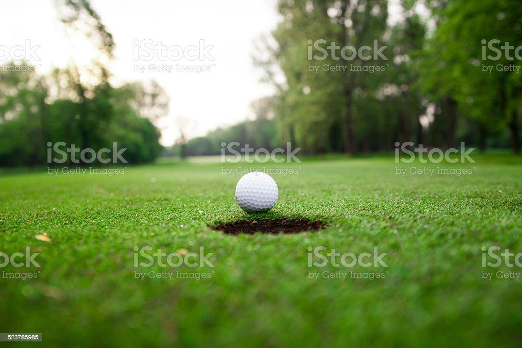 Golf ball on green meadow. stock photo