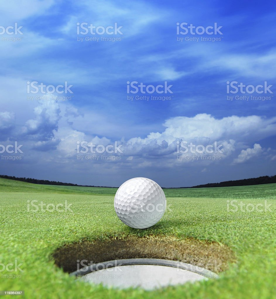 golf ball on lip stock photo