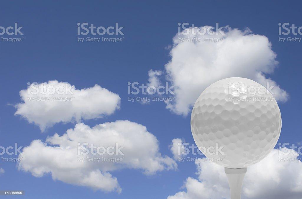 Golf Ball on Tee against Sky stock photo