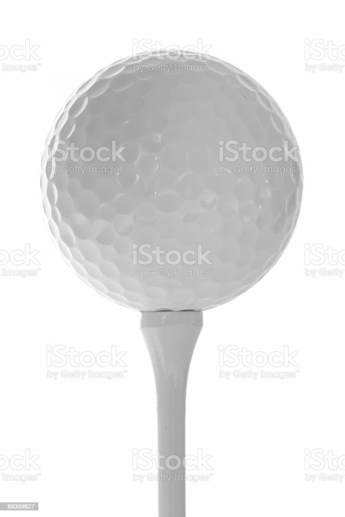 Golf Ball on Tee against White Background royalty-free stock photo