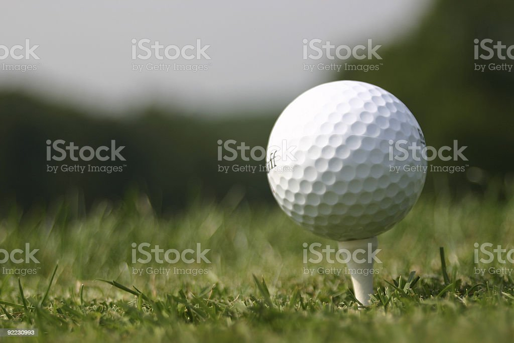 Golf Ball on Tee at real Course royalty-free stock photo