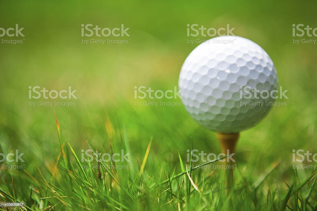 golf ball on tee. green grass. royalty-free stock photo