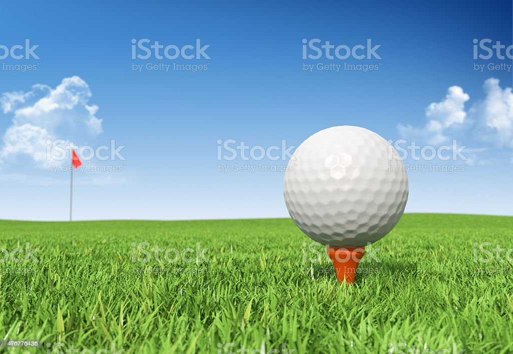 Golf ball on tee stock photo