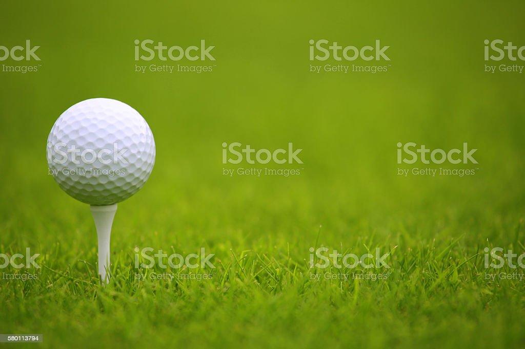 Golf ball on tee stock photo