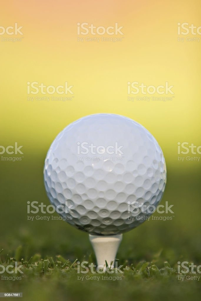 Golf ball on tee royalty-free stock photo