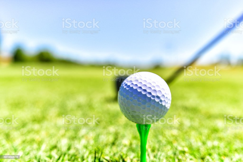 Golf Ball on Tee with Club Ready to Swing stock photo
