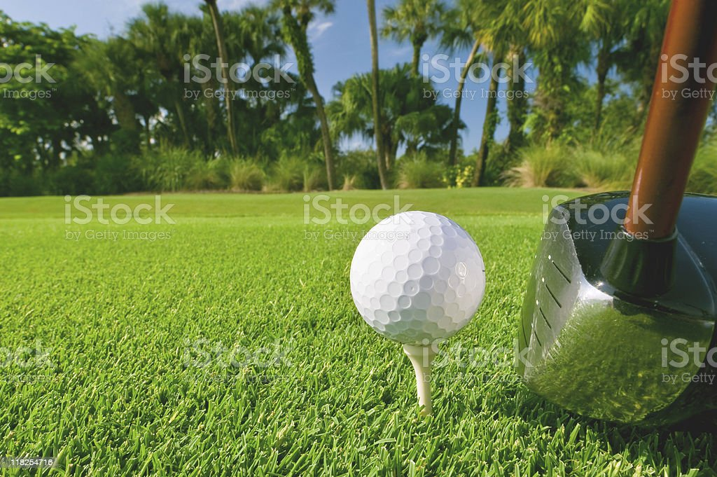golf ball on tee with driver at florida course stock photo