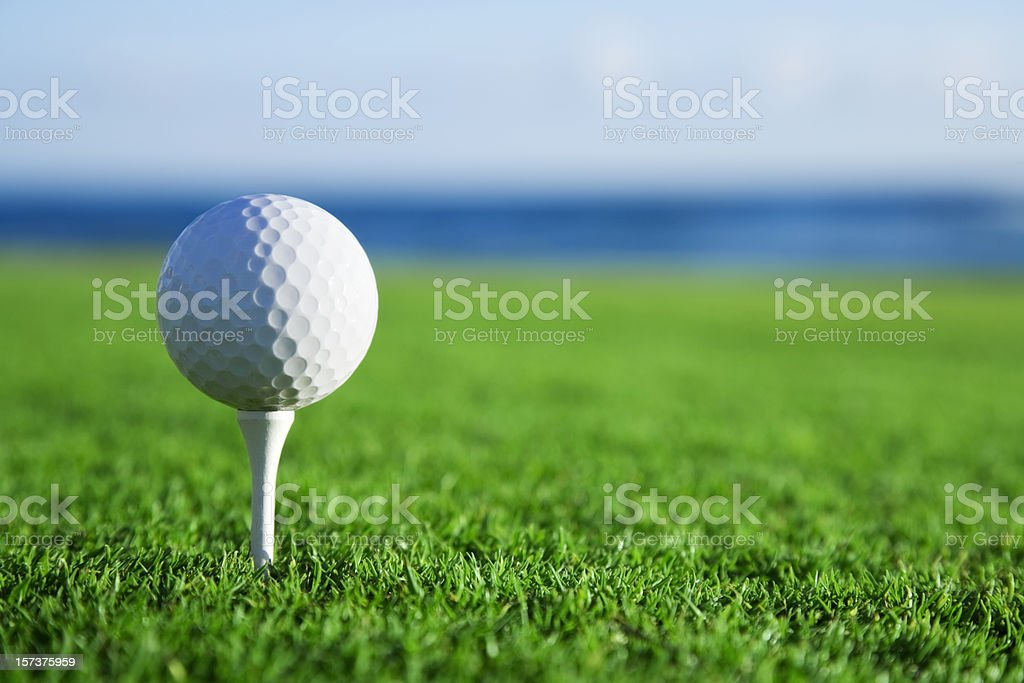 Golf Ball on Tee with Ocean View royalty-free stock photo