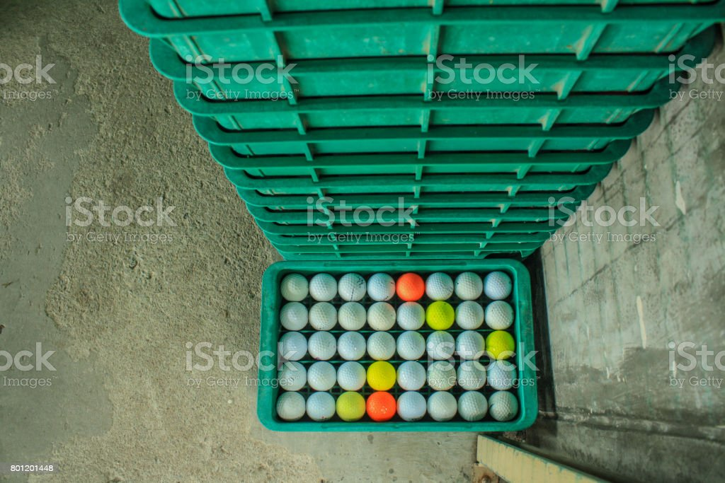 Golf ball on the course, driving range stock photo