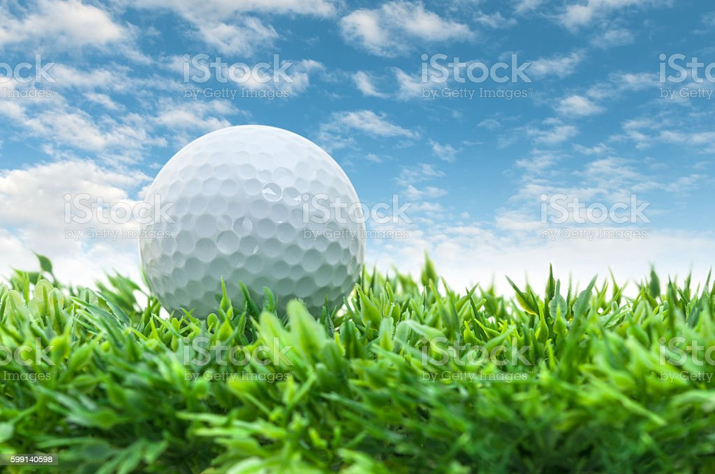Golf ball on the way stock photo