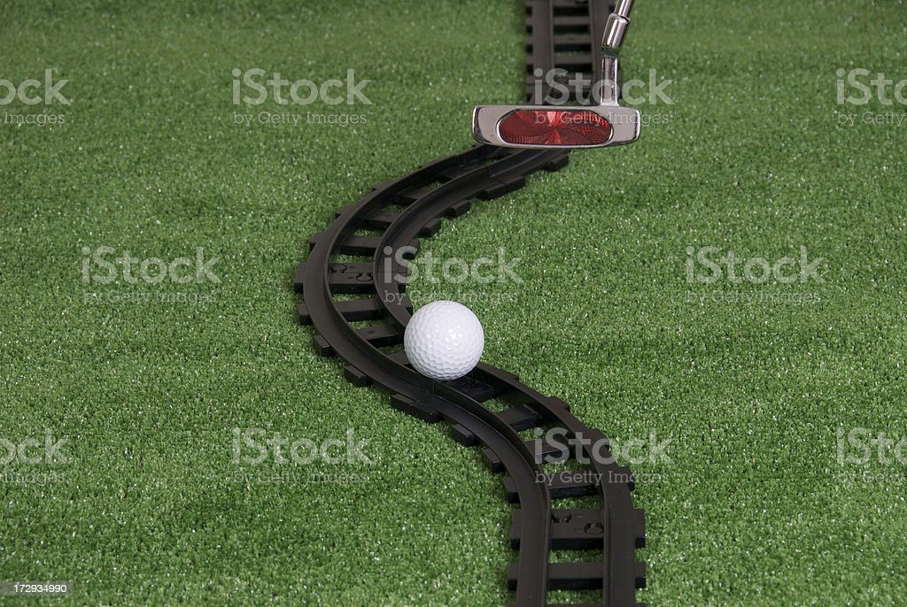 Golf ball on tracks stock photo