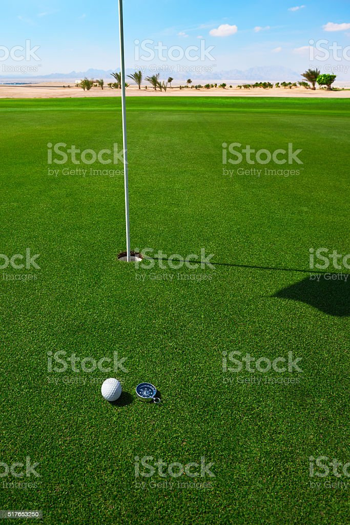 golf ball right into the hole stock photo