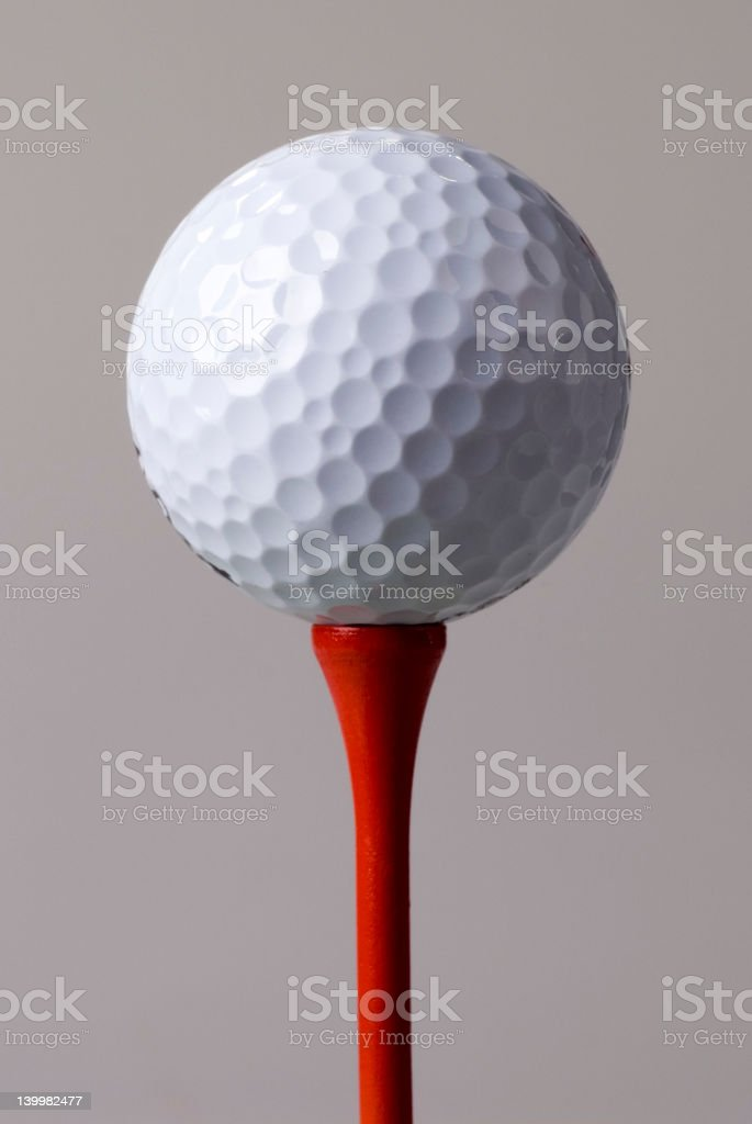 Golf ball teed up royalty-free stock photo