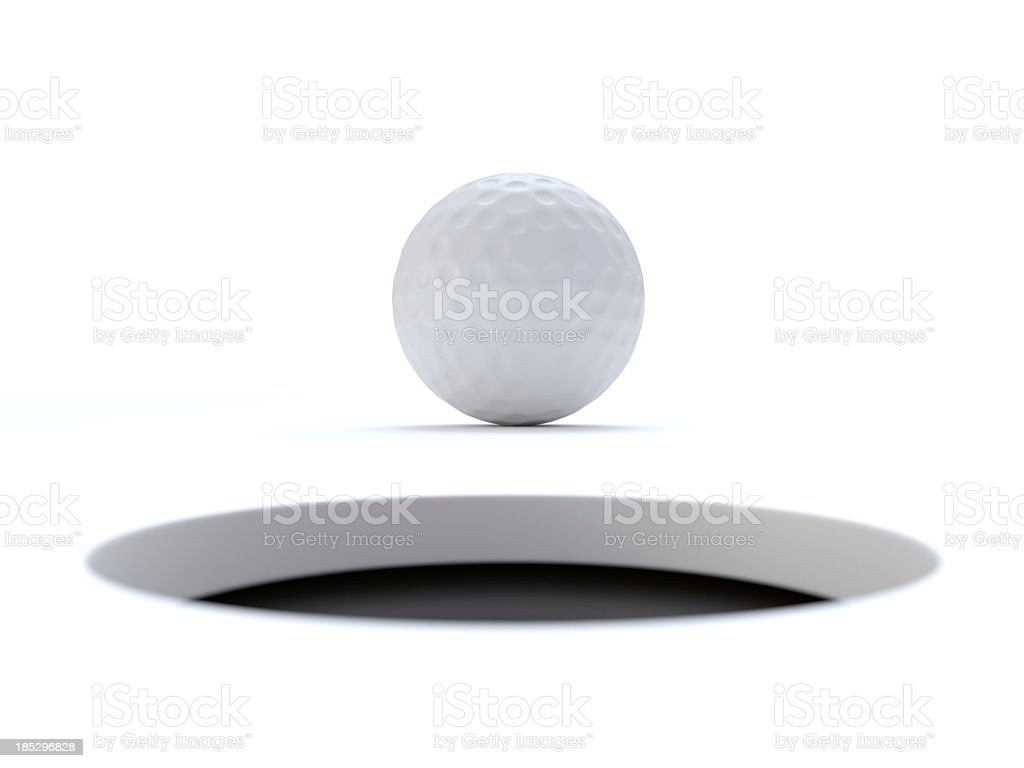 Golf ball very close to the hole stock photo