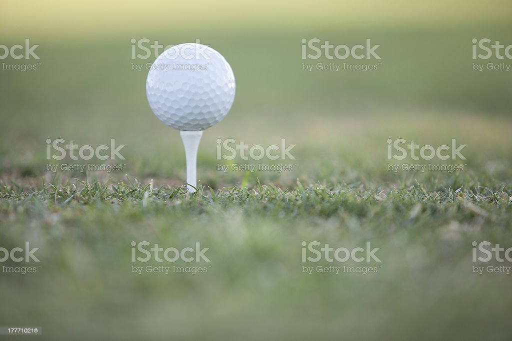 Golf ball with a lot of bokeh royalty-free stock photo