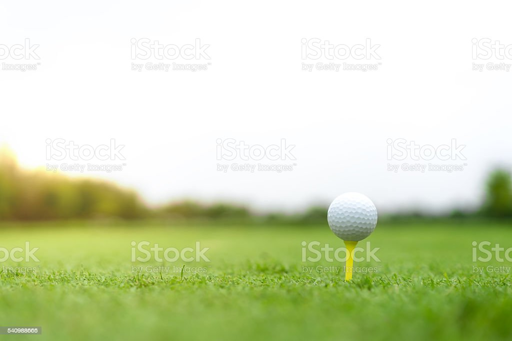 Golf ball with clipping path, copy space on sky stock photo