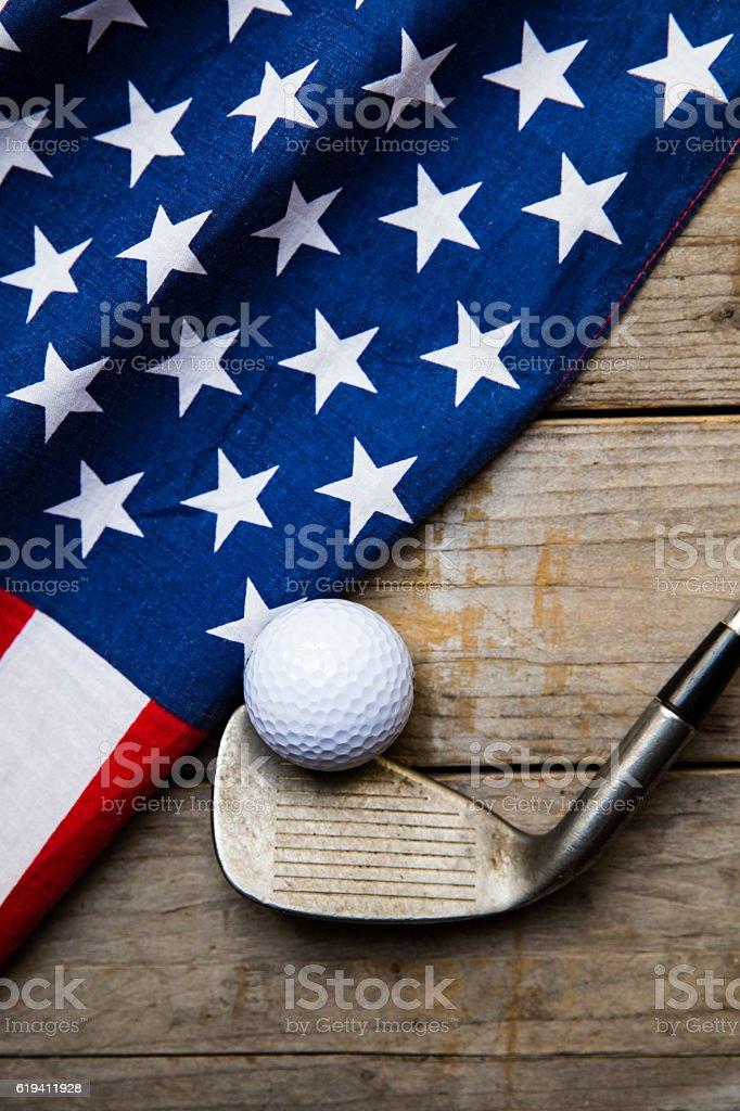 Golf ball with flag of USA on wood table stock photo