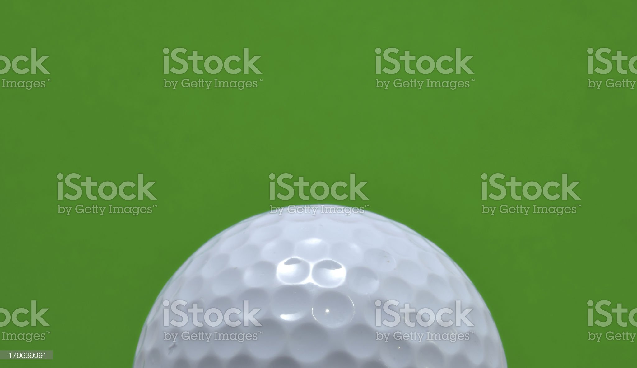 Golf Ball with Green Background royalty-free stock photo