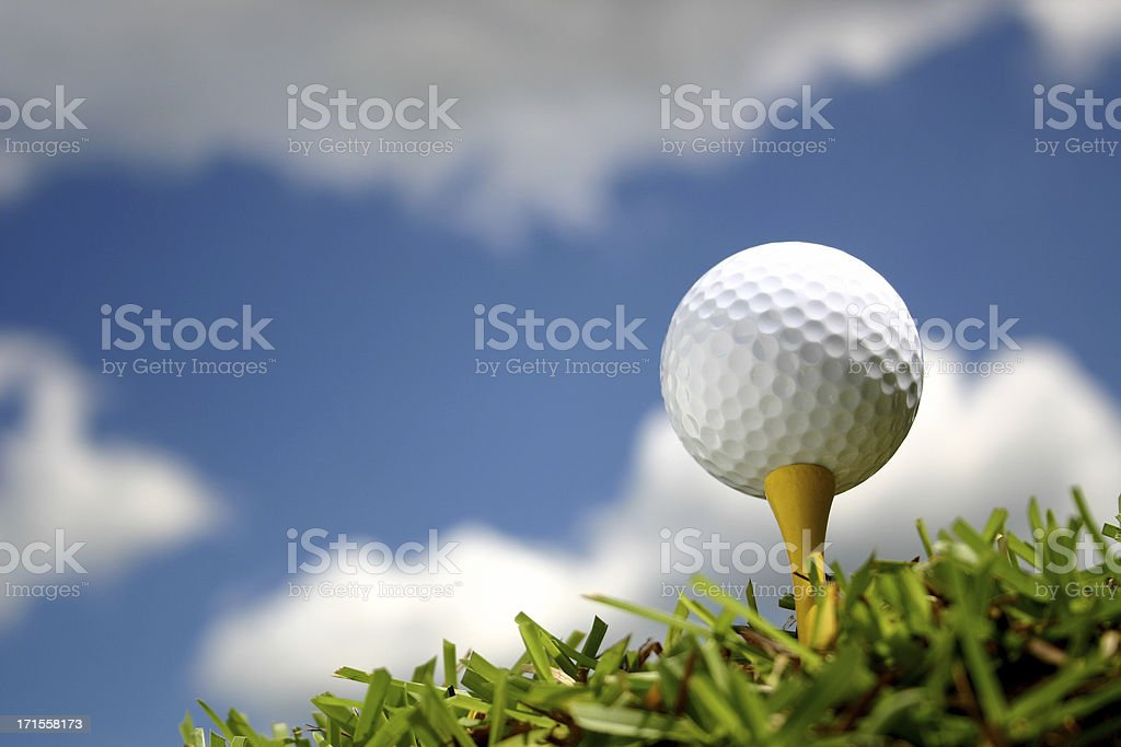 Golf Ball with Puffy Clouds royalty-free stock photo