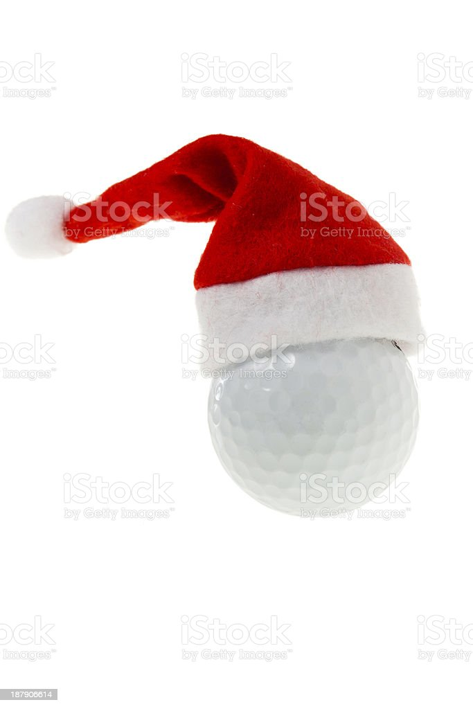 Golf ball with santa hat royalty-free stock photo