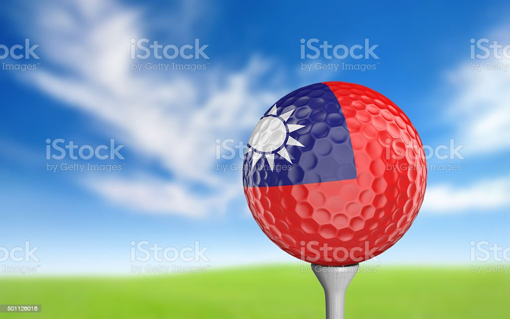 Golf ball with Taiwan flag colors sitting on a tee stock photo