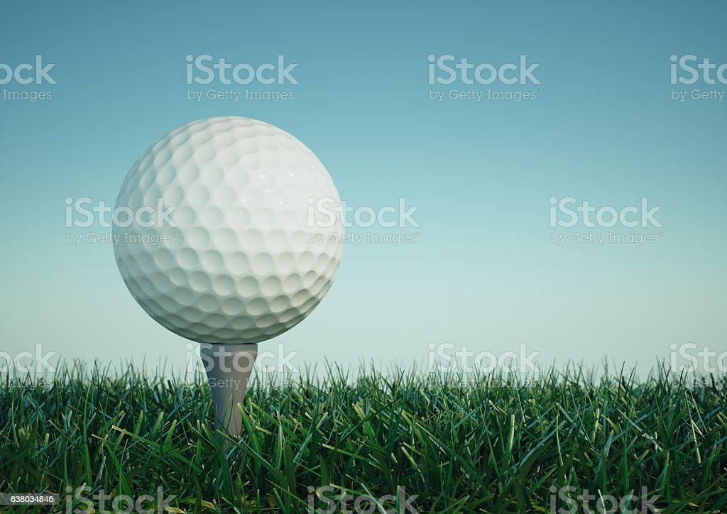 Golf ball with tee in the grass stock photo