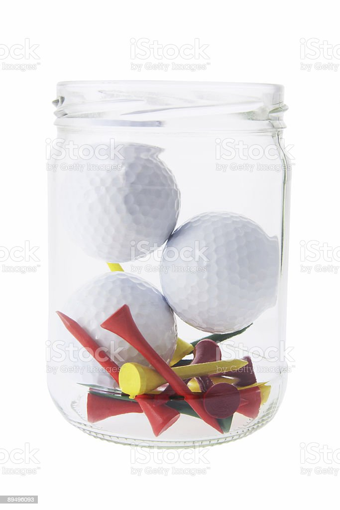 Golf Balls and Tees in Bottle stock photo