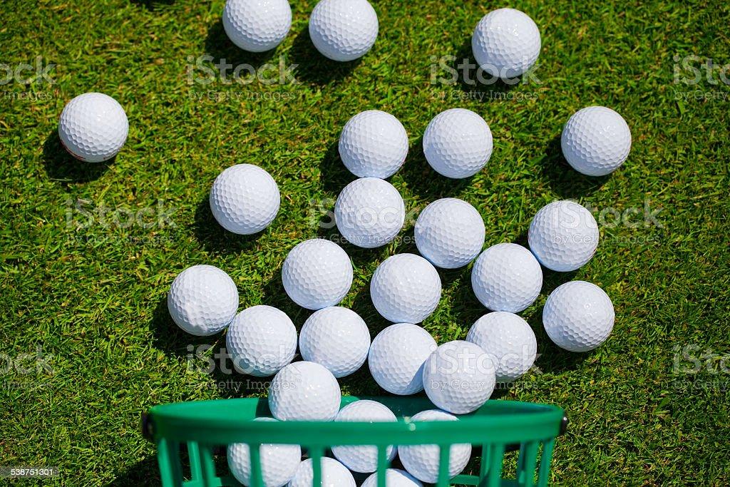 Golf balls basket stock photo