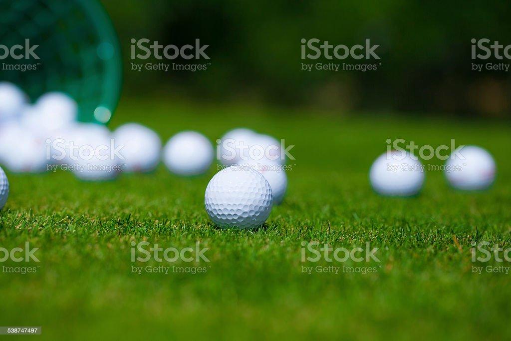 Golf balls bucket stock photo