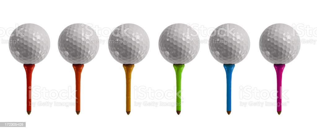 6 golf balls nestled on different colored picks royalty-free stock photo