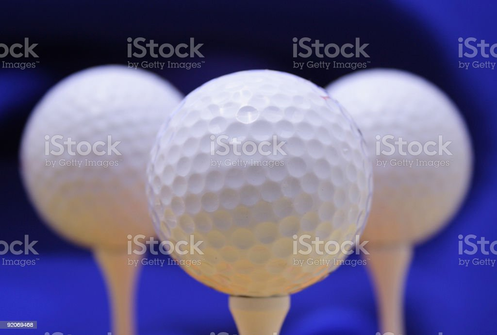 Golf Balls on blue background royalty-free stock photo