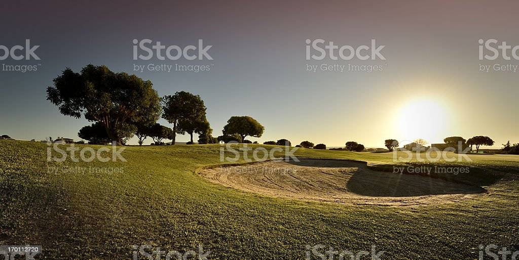 Golf bunker against setting sun royalty-free stock photo